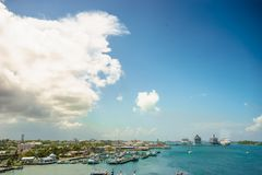 Four giant cruise ships in a row at Nassau port with a lot of yachts foreground. Bahamas.  Royalty Free Stock Image