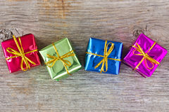 Four gifts on the wooden floor Royalty Free Stock Images