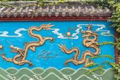 Four-Gilding dragon wall. Dragon Wall is a unique form of architecture in China. It has a dragon wall, three dragon walls, five dragon walls, seven dragon walls royalty free stock images
