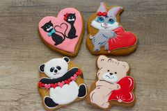 Gingerbread with drawings of the beast with hearts for the feast of the holy valentine. Four gingerbread with animals, with hearts on holiday, valentine Royalty Free Stock Photography