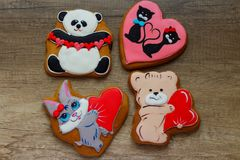 Gingerbread with drawings of the beast with hearts for the feast of the holy valentine. Four gingerbread with animals, with hearts on holiday, valentine Royalty Free Stock Image
