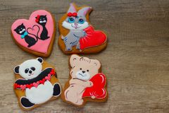 Gingerbread with drawings of the beast with hearts for the feast of the holy valentine. Four gingerbread with animals, with hearts on holiday, valentine Stock Photos