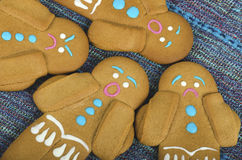 Four gingerbread man cookies Stock Images