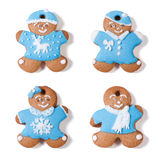 Four gingerbread man isolated Stock Images