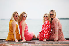 Four girl friends laughing and having fun Stock Images