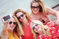 Four girl friends laughing and having fun Royalty Free Stock Images