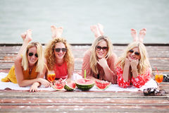 Four girl friends laughing and having fun Stock Photography