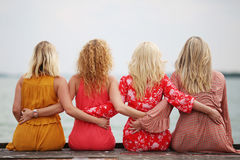 Four girl friends laughing and having fun Royalty Free Stock Image