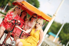 Four girl friends on a tourist bike Stock Photo
