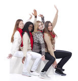 Four girlfriends with different derivation with hands up Royalty Free Stock Images