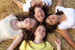 Four girls. Resting on hay royalty free stock photos