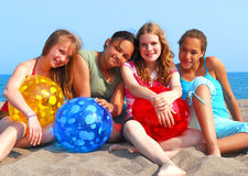 Four girls on a beach Stock Photo