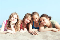 Four girls on a beach stock photography