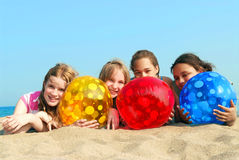Four girls on a beach Royalty Free Stock Image