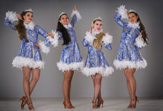 Four girls dressed as Snow Maiden celebrate Christmas Stock Photography