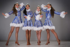Four girls dressed as Snow Maiden celebrate Christmas Stock Images