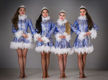 Four girls dressed as Snow Maiden celebrate Christmas Royalty Free Stock Photography