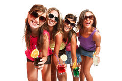 Four girls fun with a drink Royalty Free Stock Images