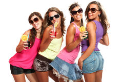 Four girls fun with a drink Stock Images
