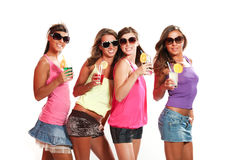 Four girls fun with a drink Royalty Free Stock Image
