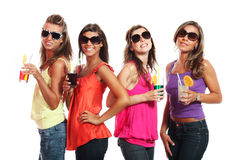 Four girls fun with a drink Royalty Free Stock Photos