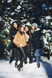 Four girls have fun in the forest in winter Royalty Free Stock Photography