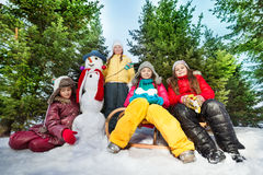 Four girls made funny snowman at the forest Royalty Free Stock Images