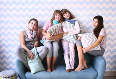 Four girls on pajama party with pillows Royalty Free Stock Photography