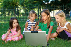 Four girls in the park Stock Photography