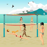 Four girls playing volleyball on the beach. Beach volleyball Stock Image
