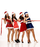 Four girls pull ribbon Royalty Free Stock Photo