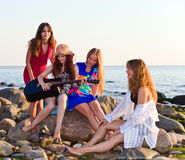 Four girls on seacoast Stock Photo