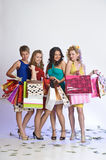 Four girls with shopping happy Stock Images