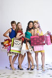 Four girls with shopping happy Stock Photos