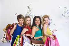 Four girls with shopping happy Stock Photography