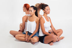 Four girls sitting on the floor Royalty Free Stock Photos