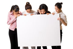 Four girls with a white sign Royalty Free Stock Photo