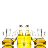 Four glass bottles with extra olive oil Royalty Free Stock Images