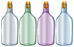 Four glass bottles Royalty Free Stock Photos