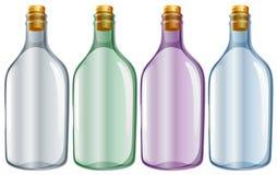 Four glass bottles Royalty Free Stock Photos