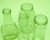 Four glass bottles and jars for recycling Stock Images