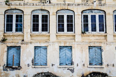 Four Glass and Four Shuttered Windows Stock Photo