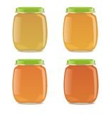 Four glass jars with baby food Royalty Free Stock Photography