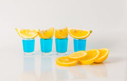 Four glasses of blue kamikaze, glamorous drink, mixed drink pour Stock Photos