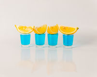 Four glasses of blue kamikaze, glamorous drink, mixed drink pour Royalty Free Stock Photography