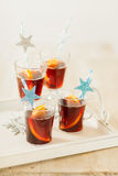 Four glasses of Christmas punch Royalty Free Stock Photos