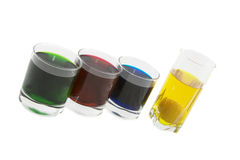 Four glasses with coloured cocktails. Isolated over white background Stock Image