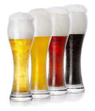 Four glasses of different fresh foamy beer Royalty Free Stock Image
