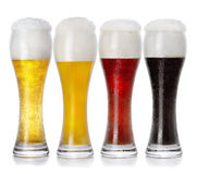 Four glasses of different fresh foamy beer Stock Images