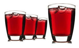 Four glasses of red fruit juice with ice Stock Photos